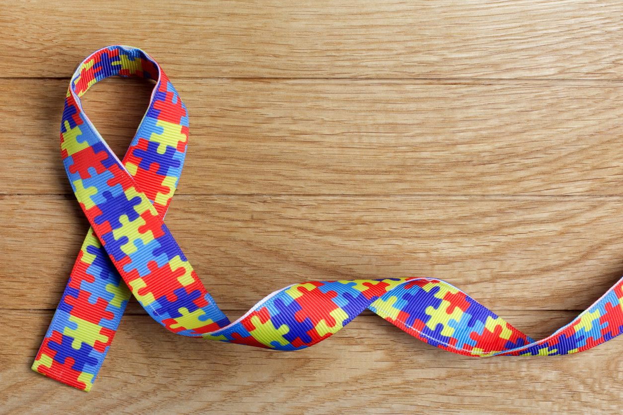 puzzle piece ribbon logo